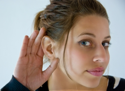 woman-with-hand-behind-ear